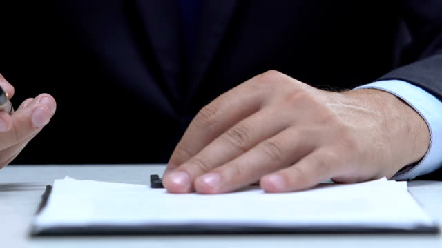Notary public proposing client to sign up document, consulting service, law