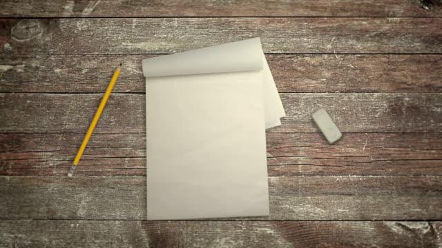 stockvideo's en b-roll-footage met notebook potlood en gum op een bureau in stop motion - magazine mockup