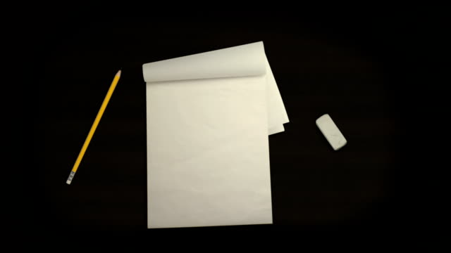 Notebook Pencil and Eraser on a Desk in Stop Motion - Vidéo