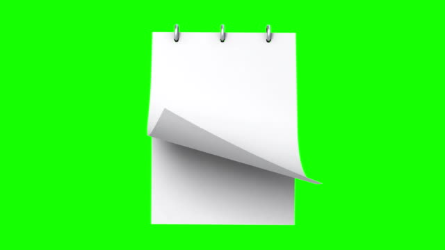 vídeos de stock e filmes b-roll de notepad with a turning page on a green background - bloco