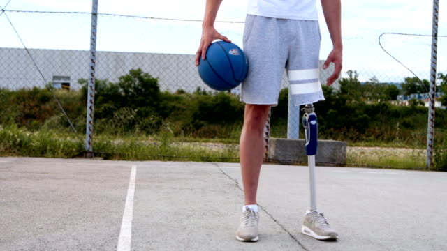 Nothing can stop me! A man with prosthetic leg, walking a dog, playing tenis and basketball artificial limb stock videos & royalty-free footage