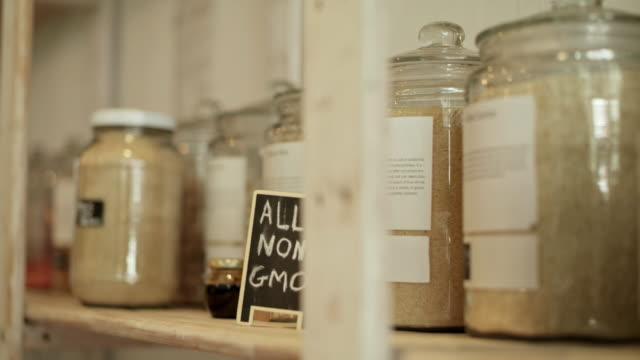 Nothing goes to waste at our store 4k video footage of glass jars filled with food on shelves in a waste free store homegrown produce stock videos & royalty-free footage