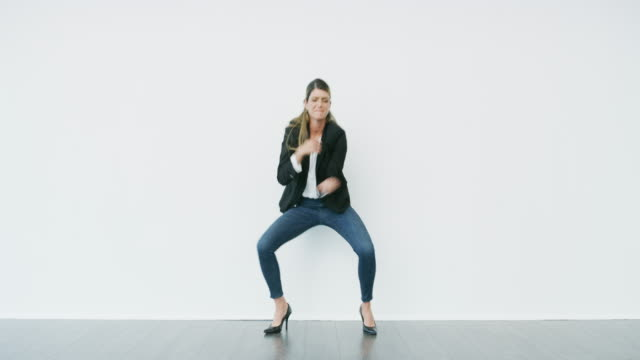 Nothing is ruining her rhythm today 4k video footage of an attractive young businesswoman dancing and feeling cheerful against a white background excitement stock videos & royalty-free footage