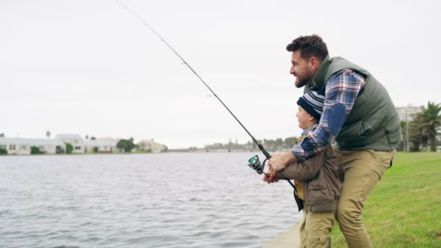 nothing says father son bonding time like a fishing trip - łowić ryby filmów i materiałów b-roll