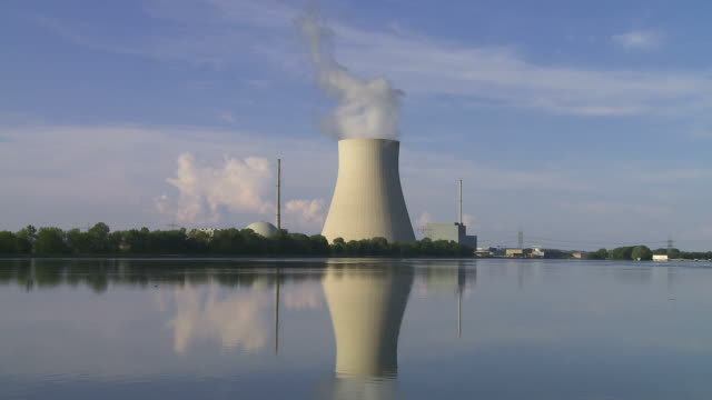 Nuclear Power Station on the River Bank Nuclear power station with steaming cooling tower (HD, NTSC, PAL). wasser videos stock videos & royalty-free footage
