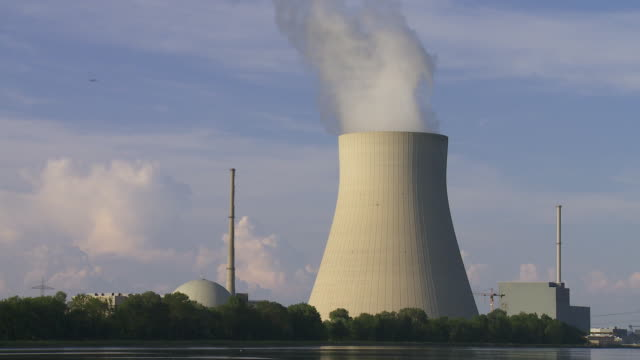 Nuclear Power Station (Time Lapse & Loop) Time lapse of nuclear power station with steaming cooling tower. wasser videos stock videos & royalty-free footage
