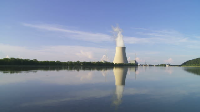 Nuclear Power Station (Time Lapse & Loop) Time lapse of nuclear power station with steaming cooling tower (HD, NTSC, PAL).     wasser videos stock videos & royalty-free footage