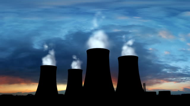 Nuclear Power Station With Steaming Cooling Towers Silhouette video