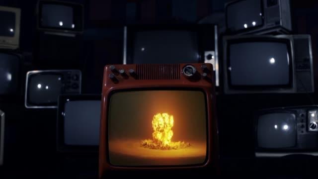 nuclear testing and atomic bomb explosion on a retro tv that explodes. - hiroshima filmów i materiałów b-roll