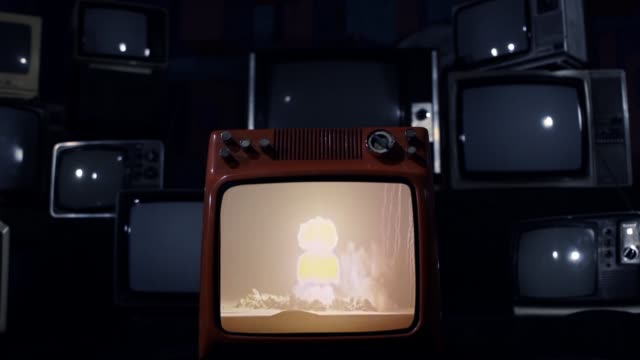 Nuclear Testing And Atomic Bomb Explosion On A Retro Tv That Explodes.