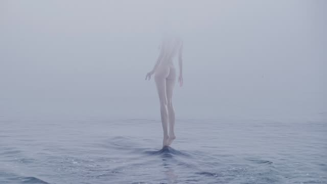 Nude female at water