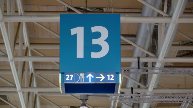 A number 13 lane number sign on the ceiling video