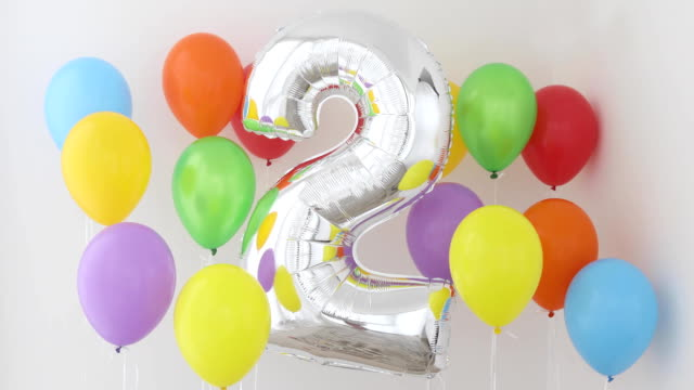 number 2 two of color balloon on light background - 2 3 anni video stock e b–roll