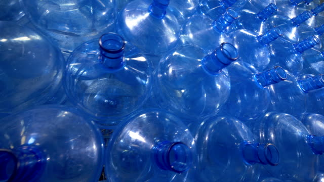 Numerous 19 liter plastic bottles for drinking water distribution. video