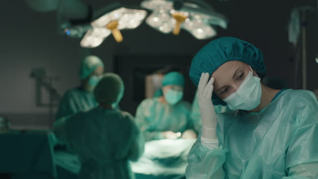 nurse feeling sad at operating room - усталый стоковые видео и кадры b-roll