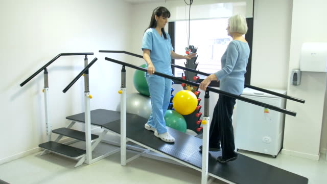 Nurse guiding patient to walk on slope in rehab video