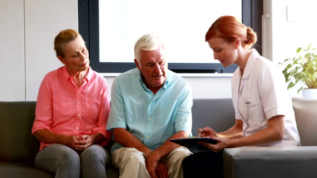 Nurse have discussion with her senior patients video