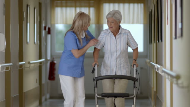hd: nurse helping senior woman with walker - elderly care bildbanksvideor och videomaterial från bakom kulisserna