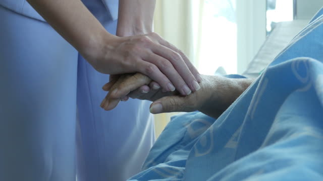 nurse hold one's hand and consoling to senior patient nurse hold one's hand and consoling to senior patient cancer patient stock videos & royalty-free footage
