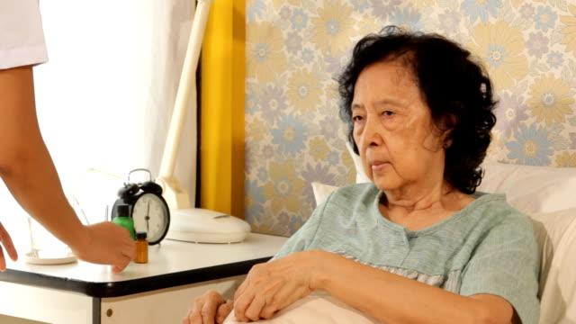Nurse take care elderly woman in hospital video