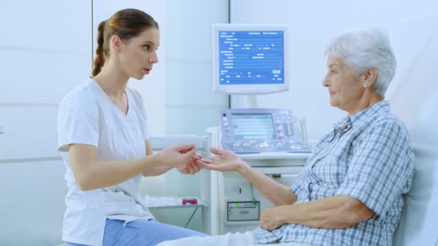 Nurse taking blood from the finger of a senior woman video