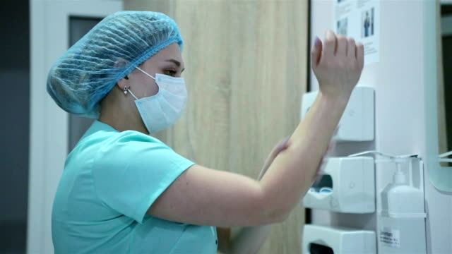 a nurse washes her hands. - mask surgery video stock e b–roll