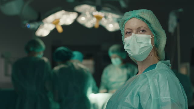 Nurse with surgery mask on her face