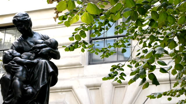 Nursing mother statue, London, UK Nursing mother statue, London, UK. Camera move then hold. 19th century style stock videos & royalty-free footage