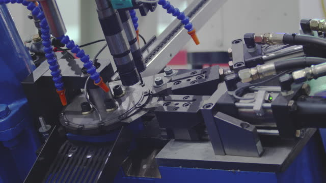 Nut Bolts screw making machine assembly-line produces small nut.