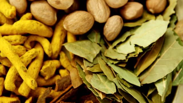 Nutmeg, bay leaf, cinnamon stick and turmeric 4k video