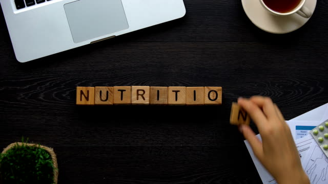 Nutrition, female doctor making word of cubes, healthy eating, proper dieting Nutrition, female doctor making word of cubes, healthy eating, proper dieting nutritionist stock videos & royalty-free footage