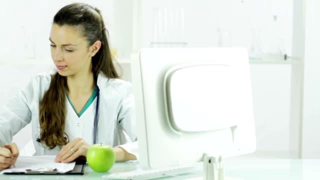Nutritionist Handing Apple Fruit Healthy Diet Choice Concept Nutritionist Handing Apple Fruit Healthy Diet Choice Concept nutritionist stock videos & royalty-free footage