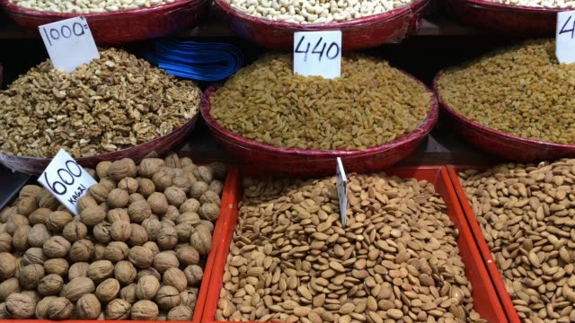 Nuts and raisins displayed in an street market, Old Delhi, India