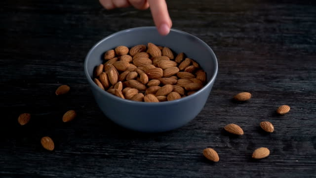 nuts are fall out from a basket - noci video stock e b–roll