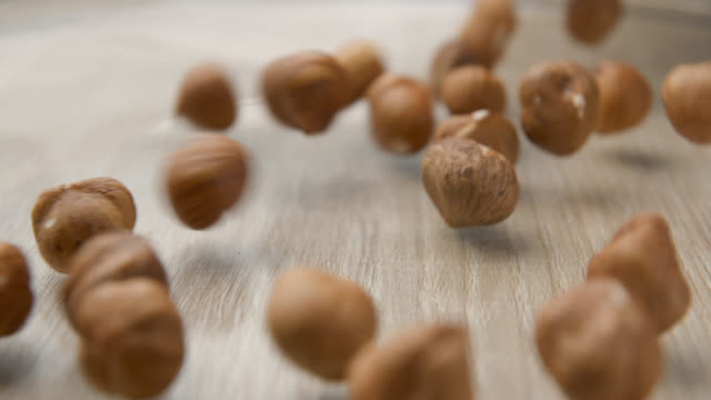 nuts falling slowmotion - noci video stock e b–roll