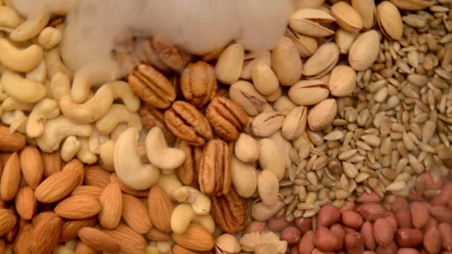 Nuts mix in a canvas bag in table. video