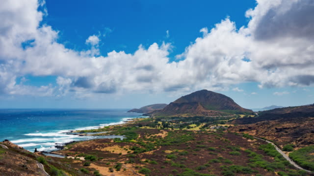 Oahu Shoreline View From Above Timelapse a time lapse on the lighthouse trail looking over into the shorline with Koko Crater Mountain in the distance oahu stock videos & royalty-free footage