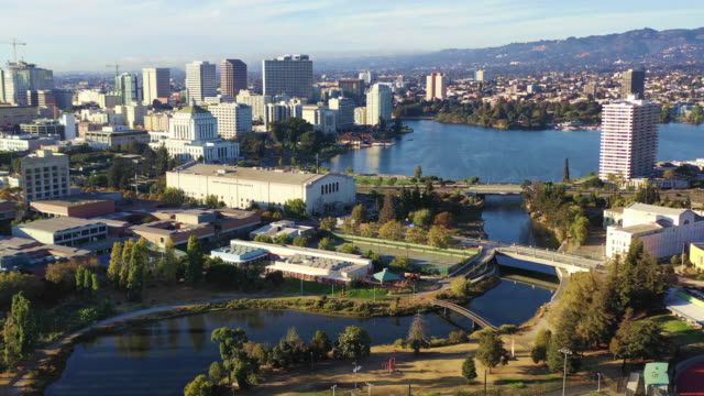 Oakland California Downtown City Skyline Lake Merritt San Francisco Track back from downtown Oakland and San Francisco can be seen in the background oakland stock videos & royalty-free footage