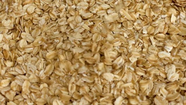 oat flakes falling slow motion
