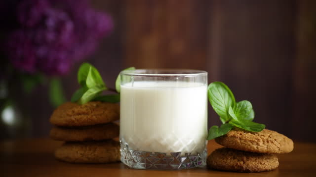 oatmeal cookies with a glass of fresh milk for breakfast video