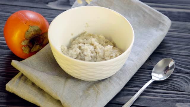 vídeos de stock e filmes b-roll de oatmeal porridge. healthy food - diospiro
