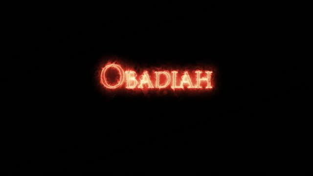 obadiah written with fire. loop - ветхий завет стоковые видео и кадры b-roll