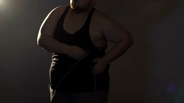 Obese man suffering from pain in back after physical exercises, overweight Obese man suffering from pain in back after physical exercises, overweight back to back stock videos & royalty-free footage