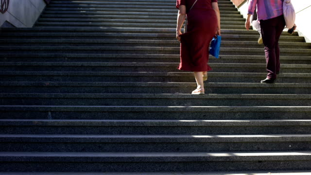 Obese woman running upstairs, intensive trainings outdoors to lose weight