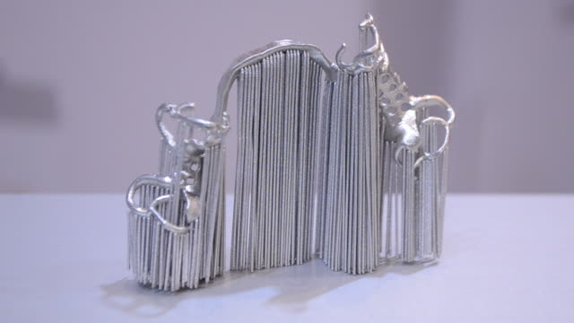 Object printed from metal powder on metal 3d printer.