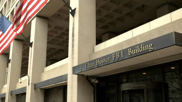 oblique view of the entrance to the fbi building in washington, d.c. - fedeltà video stock e b–roll