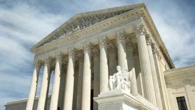 oblique zoom in shot of the us supreme court in washington d.c. - governo video stock e b–roll