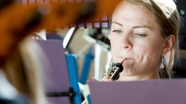 Oboe player in orchestra