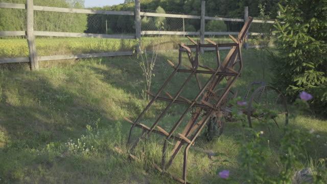 Obsolete rusty plow standing in farm backyard.