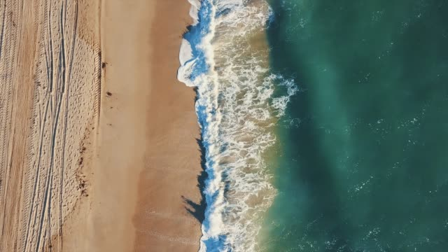 ocean beach from drone point of view - aerial beach stock videos & royalty-free footage